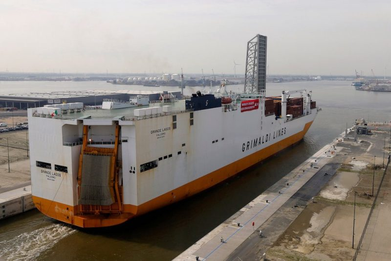 "A cargo ship crosses the world's biggest lock ""Kieldrechtsluis"" during its inauguaration at Belgium's port of Antwerp, June 10, 2016. Picture taken through a window. REUTERS/Francois Lenoir"