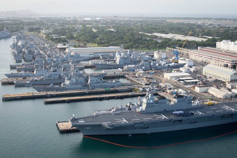 160701-N-SI773-163 JOINT BASE PEARL HARBOR-HICKHAM (July 1, 2016) An aerial view of ships moored at Joint Base Pearl Harbor-Hickam for Rim of the Pacific 2016. Twenty-six nations, more than 40 ships and submarines, more than 200 aircraft, and 25,000 personnel are participating in RIMPAC from June 30 to Aug. 4, in and around the Hawaiian Islands and Southern California. The world's largest international maritime exercise, RIMPAC provides a unique training opportunity that helps participants foster and sustain the cooperative relationships that are critical to ensuring the safety of sea lanes and security on the world's oceans. RIMPAC 2016 is the 25th exercise in the series that began in 1971. (U.S. Navy Combat Camera photo by Mass Communication Specialist First Class Ace Rheaume/Released)