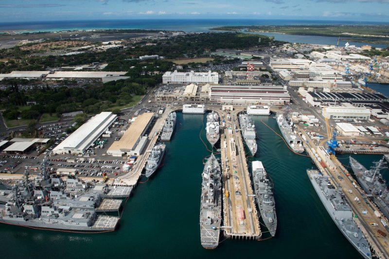 160706-N-SI773-241 JOINT BASE PEARL HARBOR-HICKAM (July 6, 2016) An aerial view of ships moored at Joint Base Pearl Harbor-Hickam for Rim of the Pacific 2016. Twenty-six nations, more than 40 ships and submarines, more than 200 aircraft, and 25,000 personnel are participating in RIMPAC from June 30 to Aug. 4, in and around the Hawaiian Islands and Southern California. The world's largest international maritime exercise, RIMPAC provides a unique training opportunity that helps participants foster and sustain the cooperative relationships that are critical to ensuring the safety of sea lanes and security on the world's oceans. RIMPAC 2016 is the 25th exercise in the series that began in 1971. (U.S. Navy Combat Camera photo by Mass Communication Specialist First Class Ace Rheaume/Released)