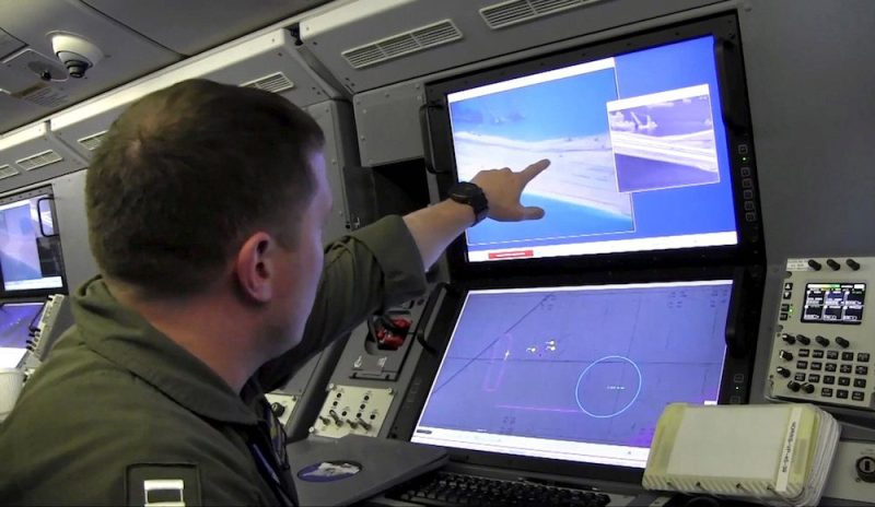 A U.S. Navy crewman aboard a P-8A Poseidon surveillance aircraft views a computer screen purportedly showing Chinese construction on the reclaimed land of Fiery Cross Reef in the disputed Spratly Islands in the South China Sea in this still image from video provided by the United States Navy May 21, 2015. U.S. Navy/Handout via Reuters