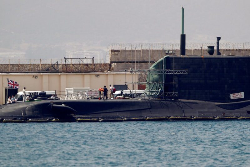 """A man leaves the British nuclear Astute-class submarine HMS Ambush docked in a port while it is repaired after it was involved in a """"glancing collision"""" with a merchant vessel off the coast of the peninsula of Gibraltar on Wednesday, in the British overseas territory of Gibraltar, July 21, 2016. REUTERS/Jon Nazca"""