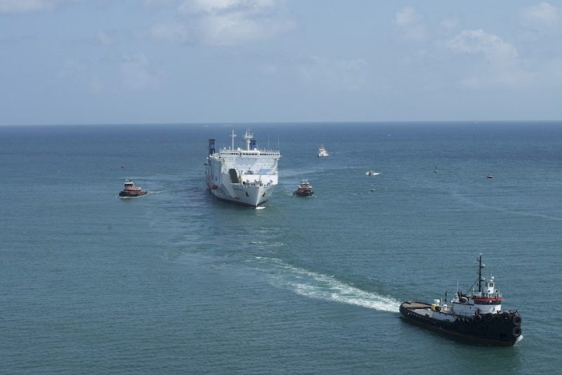 The Caribbean Fantasy, a passenger ferry vessel, is towed to Pier 15 in San Juan Harbor, Puerto Rico, Saturday, Aug. 20, 2016. 511 people were evacuated from the ship following a fire Wednesday, Aug. 17, 2016. (U.S. Coast Guard photo by Petty Officer 3rd Class Jasmine Mieszala)
