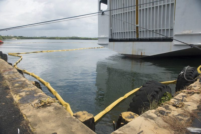Pictured here is containment boom around the Caribbean Fantasy, moored at Pier 15 in San Juan Harbor, Puerto Rico, Monday, Aug. 22, 2016. 2,500 feet of boom has been deployed around the vessel as a precautionary measure against potential discharge from the vessel. U.S. Coast Guard Photo