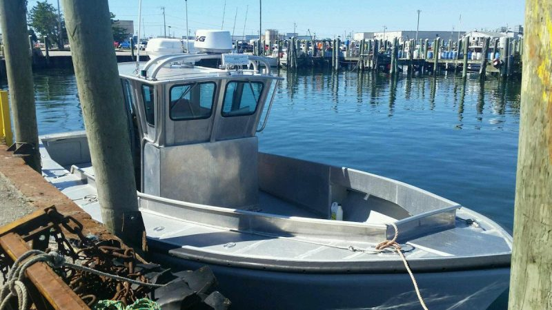 The Coast Guard is searching for this 32-foot aluminum boat, Monday, Sept. 19, 2016 near Block Island, Rhode Island. The boat and with two passengers aboard were reported as overdue after not returning from a fishing trip. U.S Coast Guard courtesy photo.