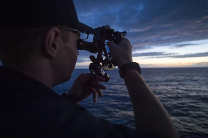 USMMA Cadet using a sextant for celestial navigation