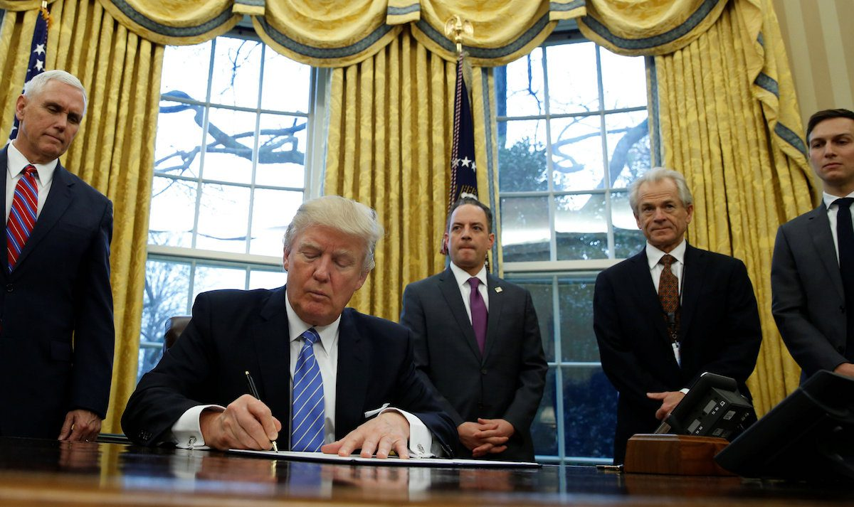 President Trump signs executive orders at the White House in Washington, January 23, 2017. Photo: REUTERS/Kevin Lamarque