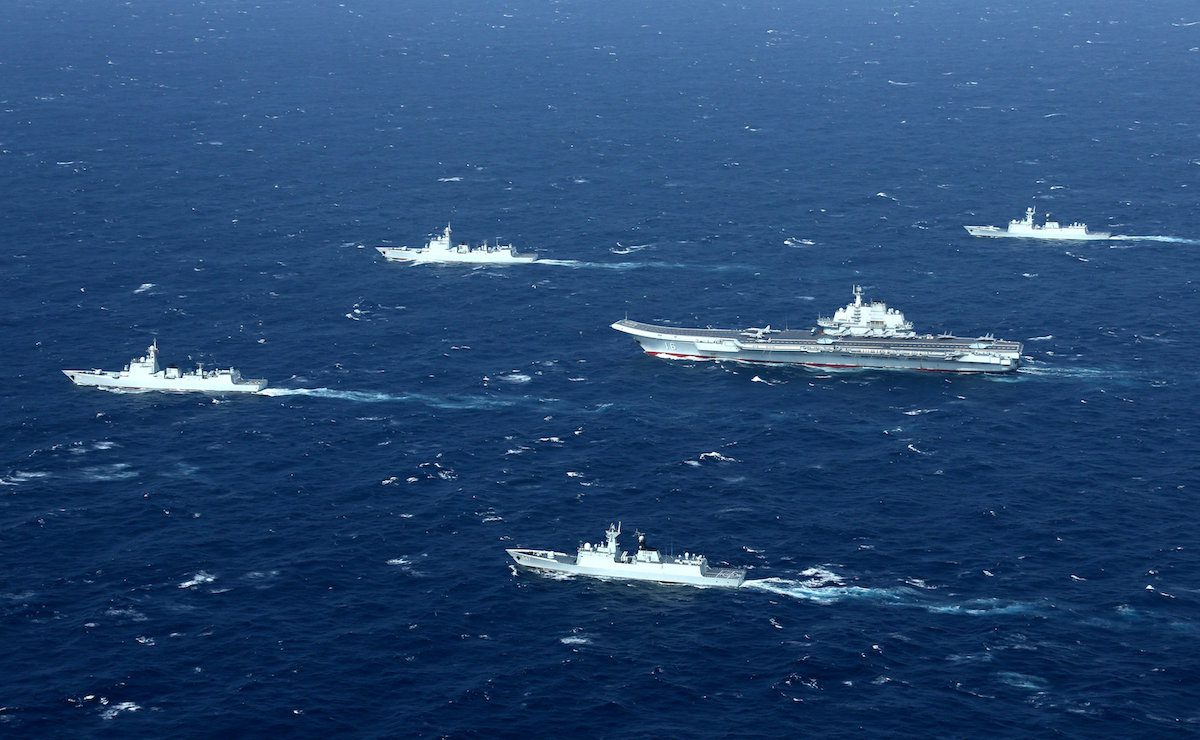 FILE PHOTO: China's Liaoning aircraft carrier with accompanying fleet conducts a drill in an area of South China Sea in this undated photo taken December, 2016. REUTERS/Stringer
