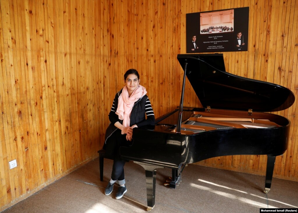 """Maram Atayee, 16, a pianist at the Afghan National Institute of Music, is concerned about a future role in government for the Taliban. """"The thing I'm most worried about is that if they return, I won't be able to continue playing music."""""""