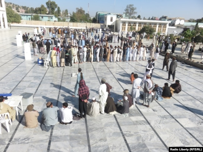 Afghans lined up to vote in eastern Khost Province on October 20.