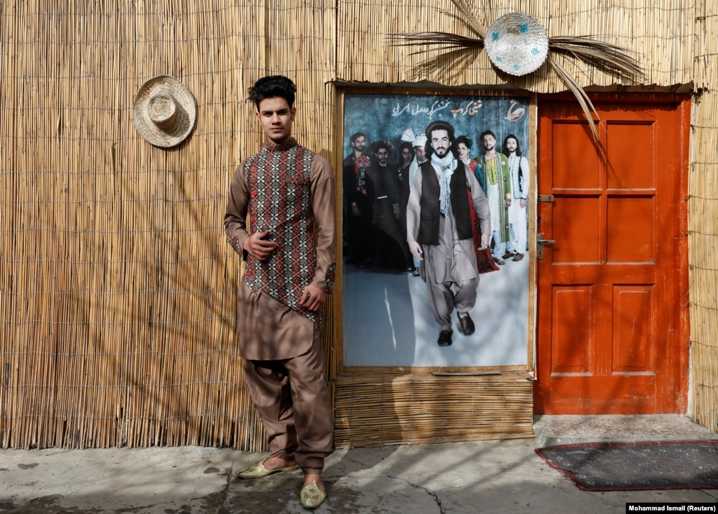 """Sultan Qasim Sayeedi, 18, scourssocial mediato study fashion. """"We're afraid that if the Taliban come, we will not be able to hold our shows."""" But he also says it's time the fighting ended. """"If American troops go, peace will come."""""""