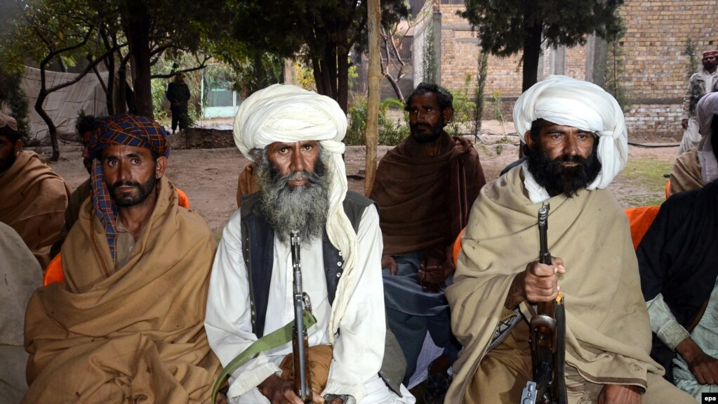 FILE: Purported members of the banned Baloch Liberation Army organization wait to hand over their weapons during a surrender ceremony in Quetta, capital of Balochistan Province in November 2015.