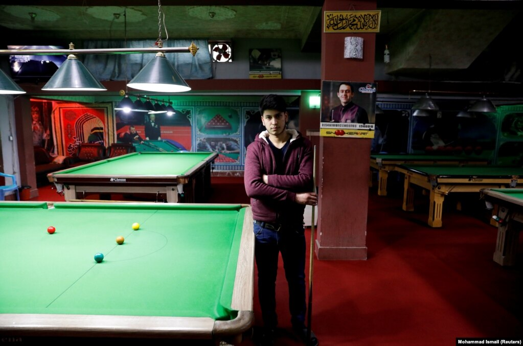 """Farzad Aslami, 18, at a snooker club in Kabul. """"We want peace for the sake of our country's welfare. We don't want any more suicide attacks and explosions."""""""