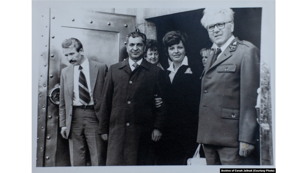 Karmal (second left) with Jiri Jelinek (right), the state forest director for the Kraslice region, near Sindelova in 1978-79.