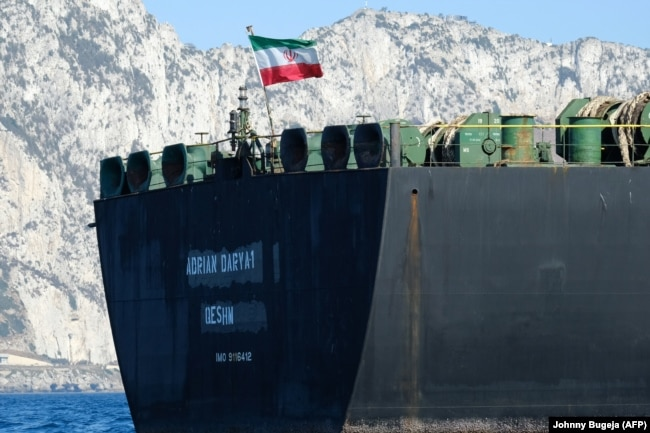 An Iranian flag flutters on board the Adrian Darya oil tanker off the coast of Gibraltar on August 18.