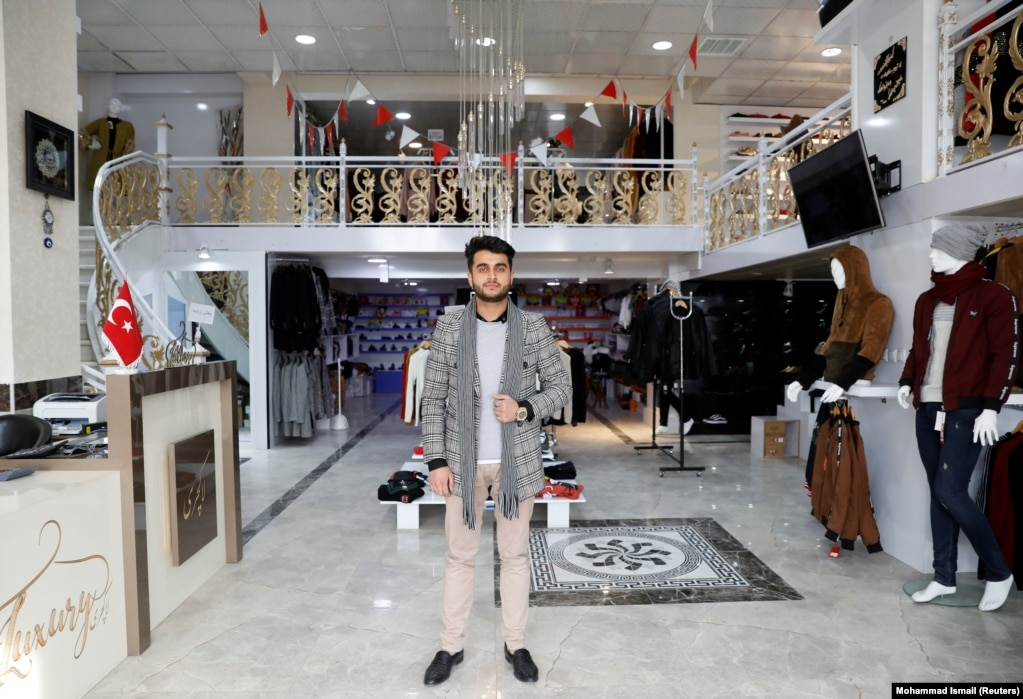 """Owner of a luxury clothes shop Sohail Ataie, 22. """"We are tired of war. What we want is peace, to live a better life."""""""