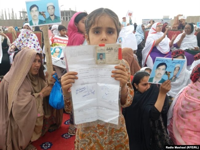 In the PTM's April 8 gathering thousands of women, children, and men held up photos, placards, or the national ID cards of their missing family members.