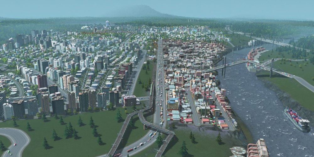 Shot of a city showing river, industrial section, and nearby commercial/residential district.