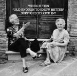 Two older women sitting on stoop