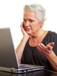 Senior woman at laptop computer
