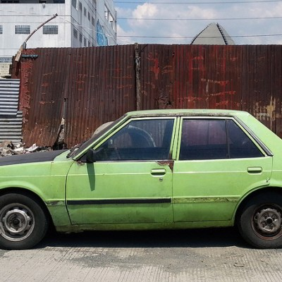 green Mitsubishi Lancer car