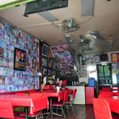 street diner with a lot of photos of famous guys on the wall