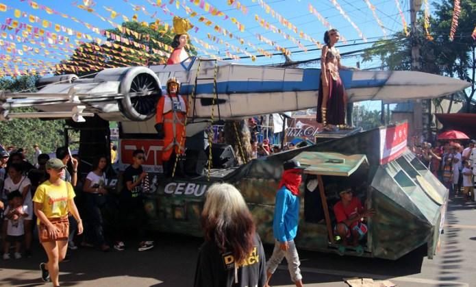 the baby Jesus, Princess Leia, and a Star Wars jet