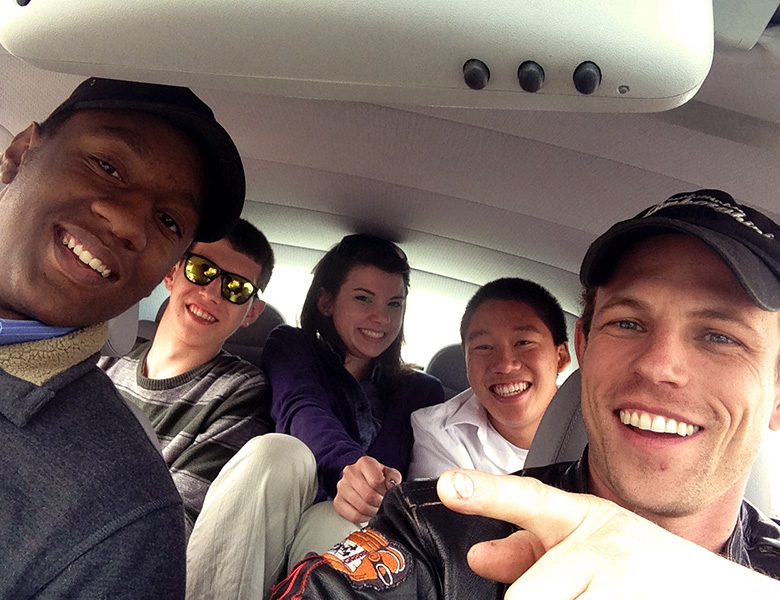 Group selfie in a Mercedes with Tiko, Chris, Taylor, Lawrence, and Casey