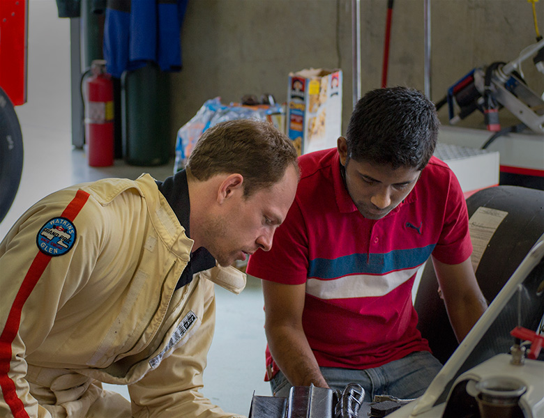 Casey and Shreyas finish setting up the tablet for remote communication with the car's programming
