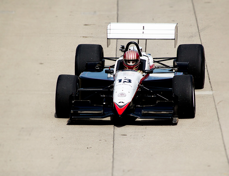 The Reynard is about to enter the Indianapolis Motor Speedway track