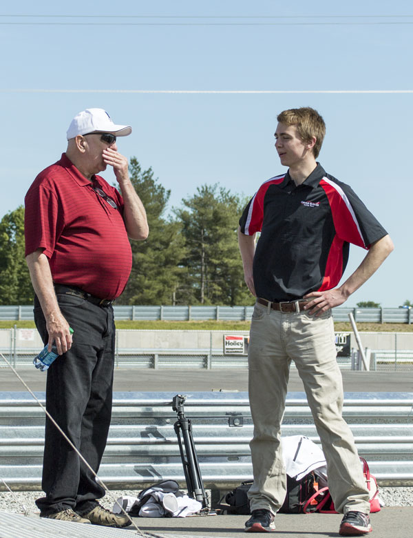 Clint Teece discusses possible future plans with team mentor, Michael Murray.
