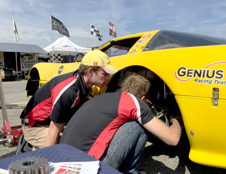 Casey and Zach work on replacing tires.