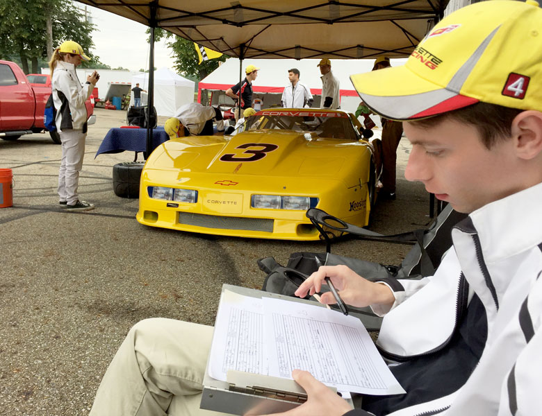Dan checks his set-up sheets to make sure that everything will be perfect for today's track conditions.