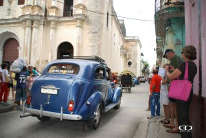 Cuba Driving Through Market