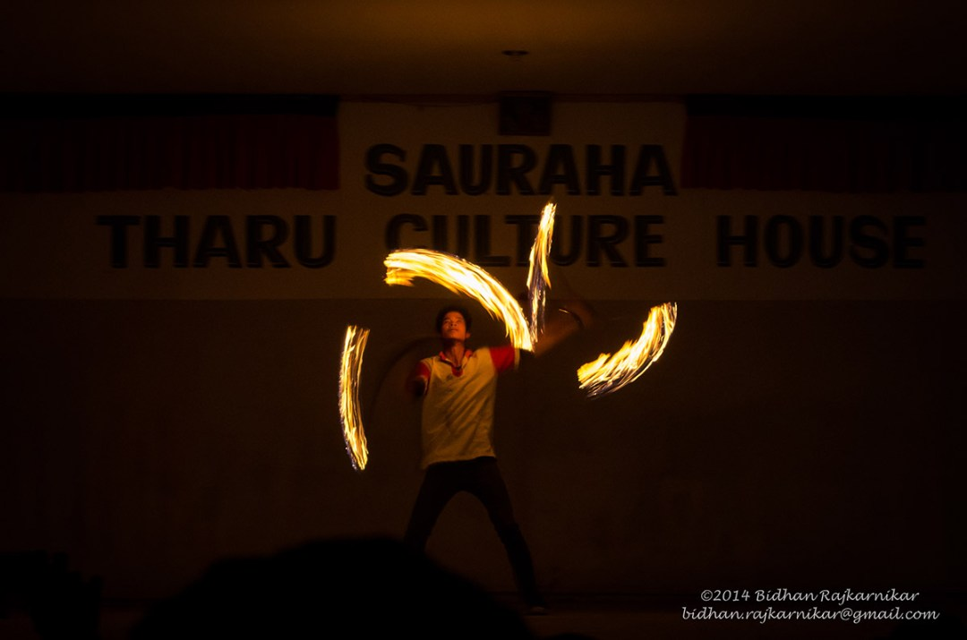 A performer playing with fire at the cultural program.