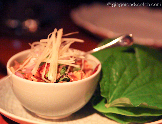 spicy pork with mint, peanuts and crunchy rice on betel leaves