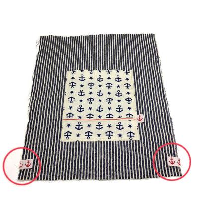 サイドの紐通しを縫い付ける