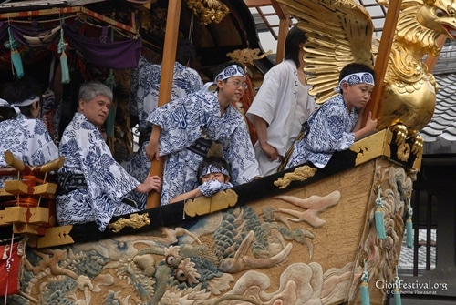 fune boko yukata boys on prow gion festival procession kyoto japan