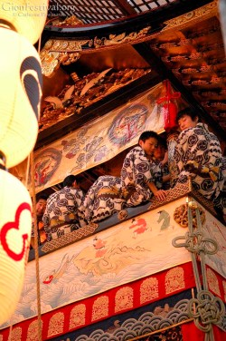 hoka boko musicians on float night lanterns gion festival kyoto japan
