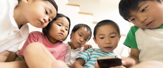 Children using a smart phone.