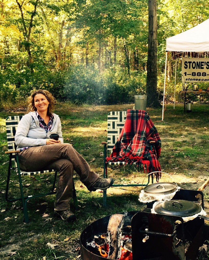 My producer, Stephanie Puglusi, enjoying a quiet moment by the fire at a Girl Camper event.