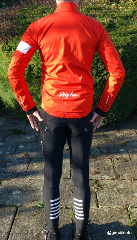 Rapha Rain Jacket from the rear. Reflective elements including the logo