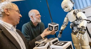 Researchers with a robot that learns simple words through conversation.