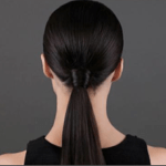 Pull hair into a low pony and wrap a little hair around the elastic.