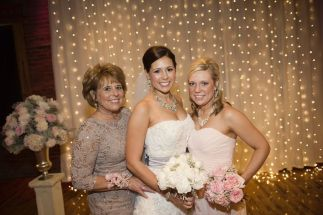 white peony bridal bouquet and pink bridesmaid bouquets