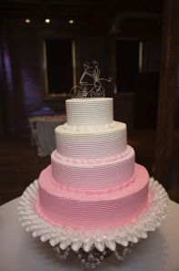 pink ombre cake with wire bike cake topper