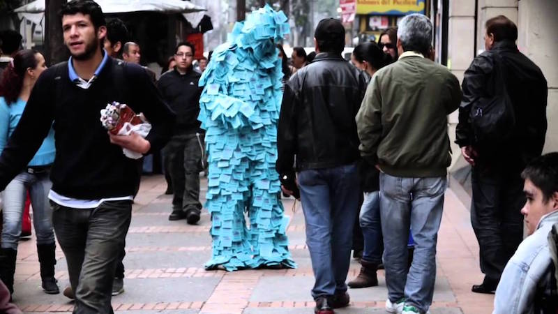 man covered in post its