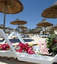 Floral tributes have been left at the scene of the attack on a beach in the Tunisian resort Sousse