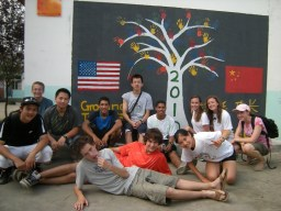 Group shot with the mural they painted at the senior center