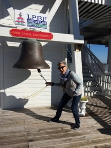 Vicki ringing the Coast Guard bell at Lake Pontchartrain Basin Foundation