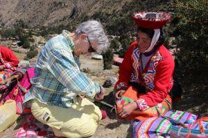 Weaving instruction in Peru